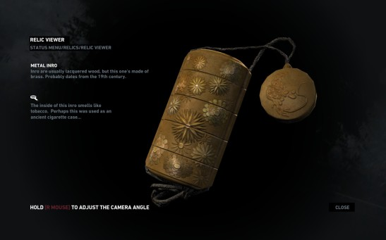 A closer look at the metal inrō case Lara finds in the Shanty Town (Photo credit: Brandon Klassen, Tomb Raider HQ Archives)