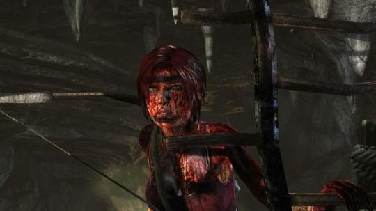 Lara looking a little worse for wear in Tomb Raider 2013 (Image credit: Matt Brett)