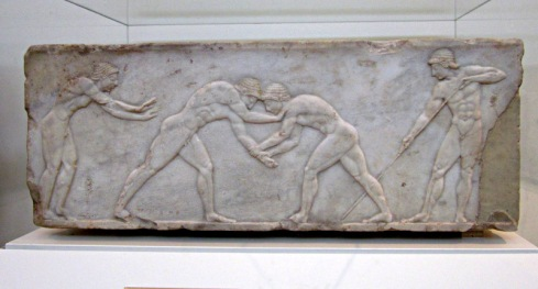 Relief of wrestlers on display in Athen's National Archaeological Museum