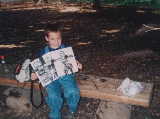 Ivan Z, aged 6, reading a game magazine with a Tomb Raider Chronicles article