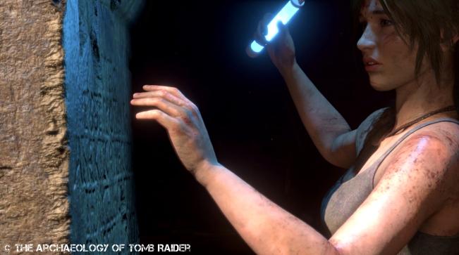 Lara attempts to decipher an ancient inscription