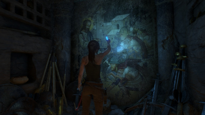 Lara examines a mural depicting the Prophet