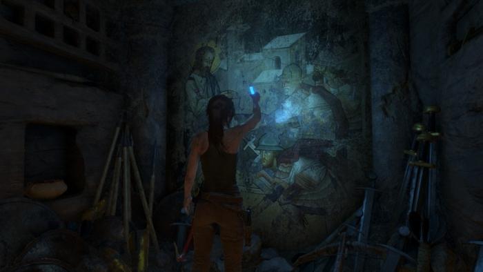 Lara examines a mural depicting the Prophet
